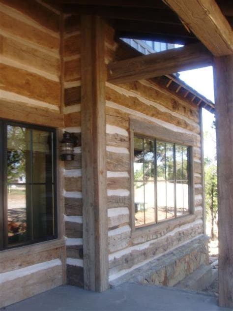 Skins from Hand Hewn Beams as Siding