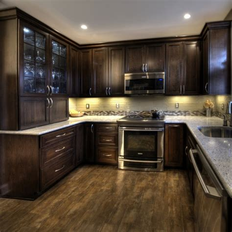 Dark cabinet, medium dark floor, light countertop @ My