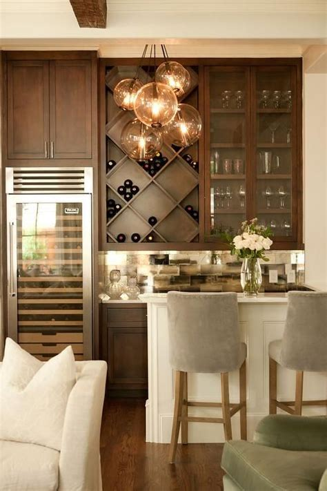 chic living room bar features dark stained shaker cabinets