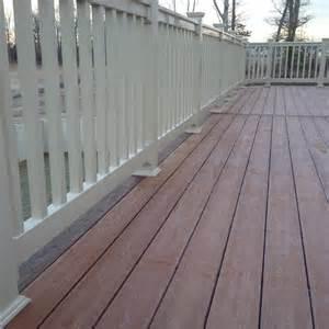 fiberon pro tect flooring on deck in western cedar color railing fascia wrap in pvc