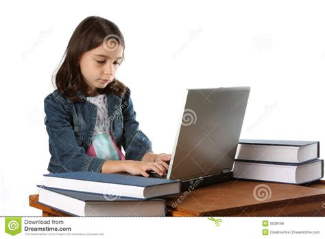 Young Girl / Child Typing On Laptop Computer Stock Photo