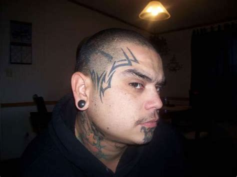 15 Awesome Tribal Face Tattoos