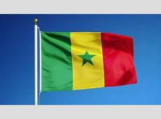 Senegal Flag Waving Against Timelapse Clouds Background