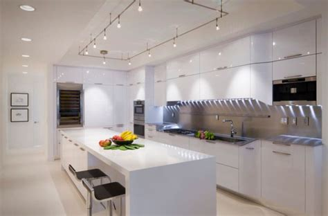cool track lighting installation above the kitchen island