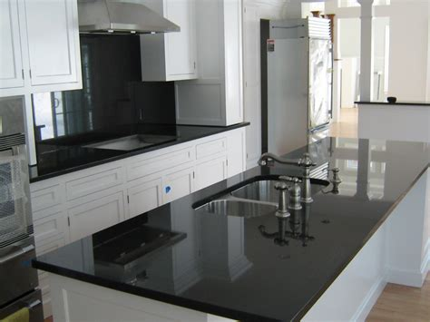 white kitchen cabinets with dark countertops absolute black granite installed design photos and reviews