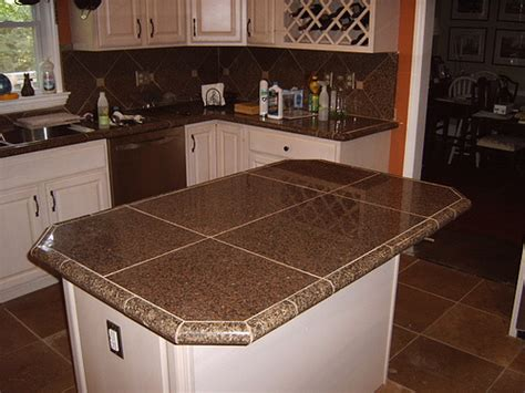 kitchen remodel with granite tile countertops and