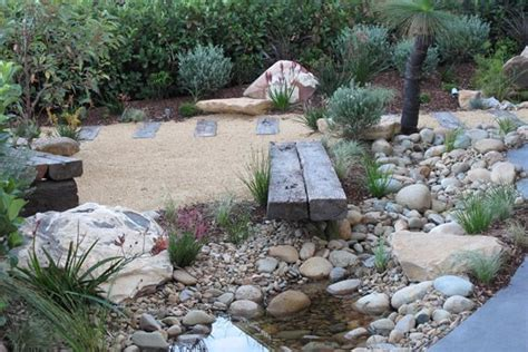 Dry Stream Bed With A Small Recycling Pond In A