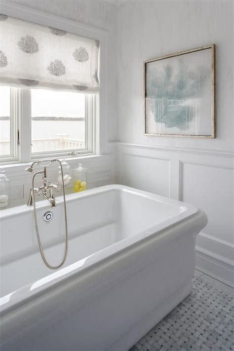 beach style bathroom with blue sea fan art cottage