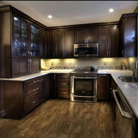 dark kitchen cabinets with light countertops cherry cabinets with a mocha finish kashmir white granite