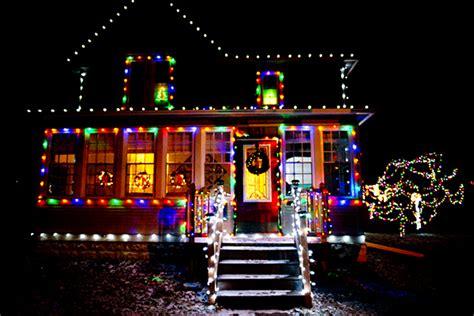 christmas lights houses near yet in thy dark streets shineth the everlasting light s