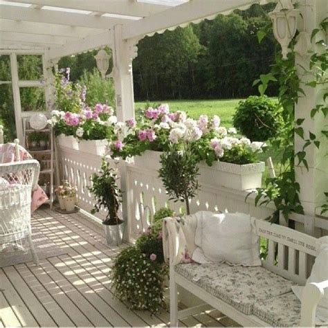 Pretty Porches And Terraces by Sun Terrace In White Decorated With Pretty Pink Flowers