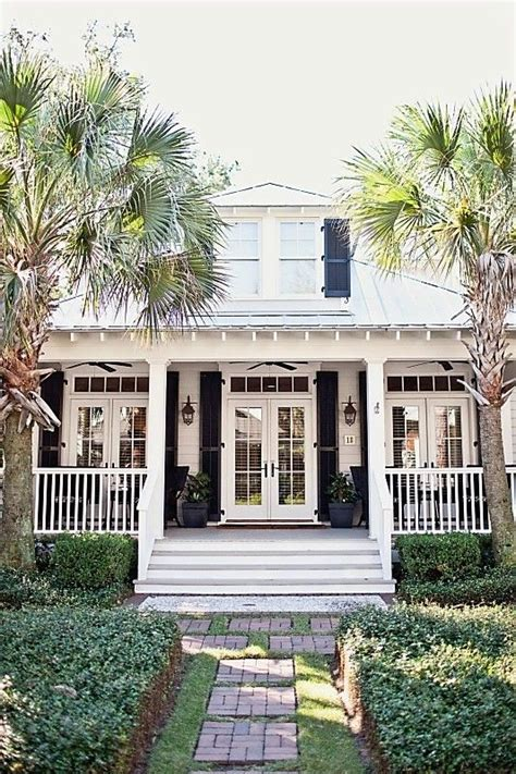 southern style architecture with french doors on either side of the front door