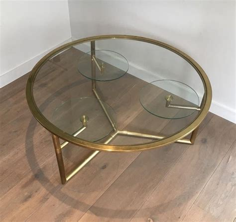 Industrial coffee table, set of 2 tables, flat pack. Beautiful Rare Round Gold Gilt Coffee Table with Removable Round Glass Shelves For Sale at 1stDibs