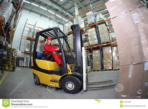 Forklift Operator At Work In Warehouse Stock Photo Image