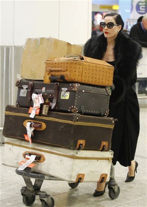 Dita Von Teese Brings Old Hollywood Glamour To Heathrow