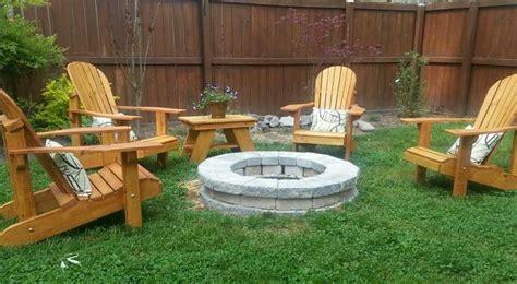 adirondack chairs around pit outdoors