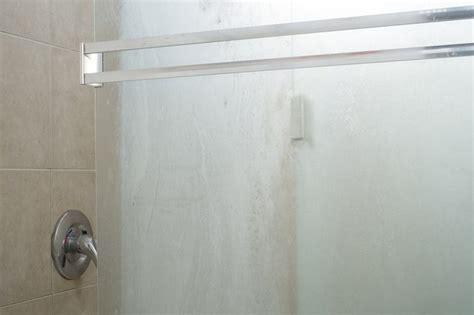 best way to clean glass shower doors the best ways to clean glass shower doors hunker