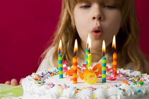 Why Do We Blow Out Candles on Birthday Cakes?   Mental Floss  Blowing