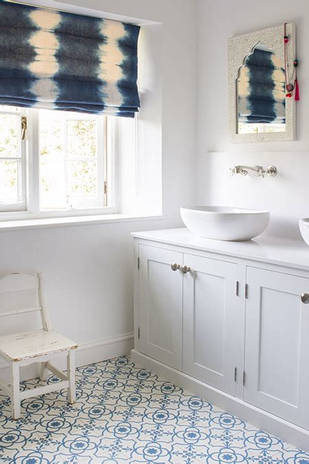 white  blue bathroom  indigo tie dyed roman shade