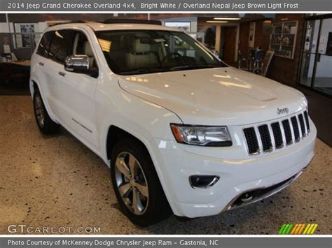 light brown jeep bright white 2014 jeep grand cherokee overland 4x4