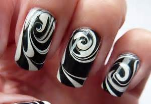 Water marble black white swirl nail art design trendy