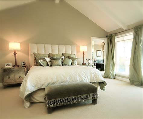 sage green accent wall    white bed