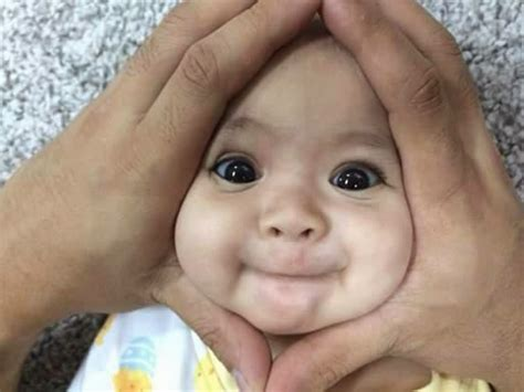 baby face cover  hands funny picture