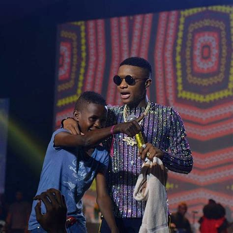 wizkid signs young ahmed  starboy promises