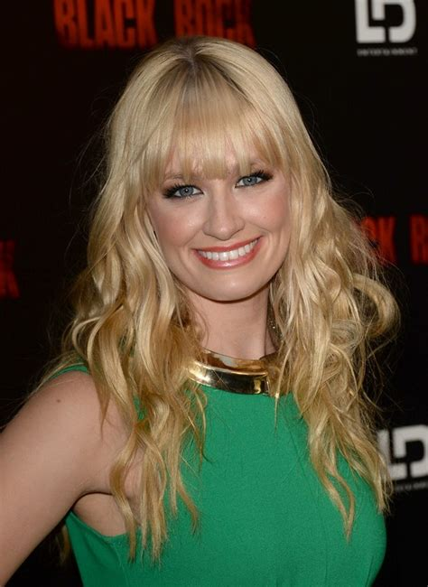 beth behrs long blonde naturally wavy hairstyle  blunt
