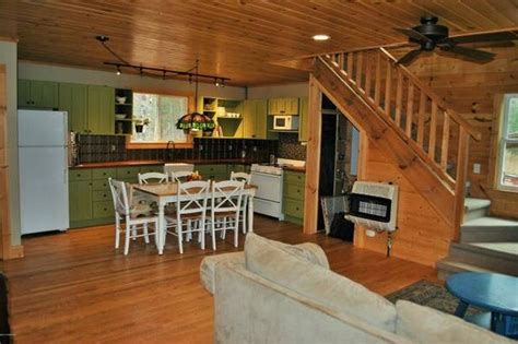 solar  grid log cabin   acres  sale