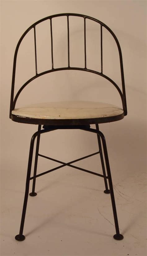 set of four wrought iron swivel chairs for sale at 1stdibs