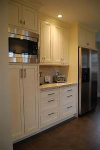Kitchen pantry cabinet, refridgerator, coffee area and