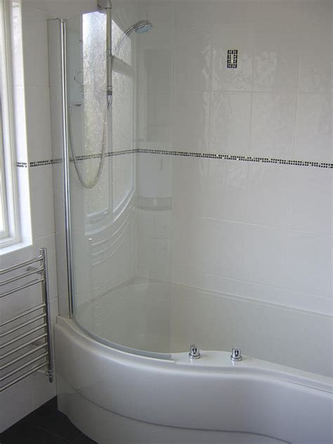 p shape shower bath  white tiles  black  silver