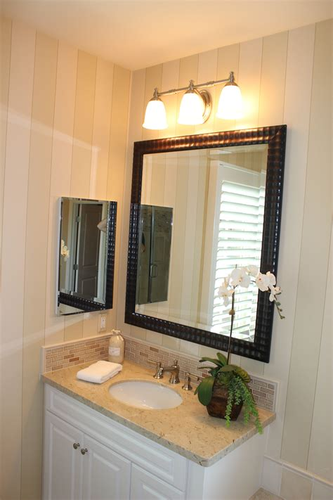 Posted onnovember 28, 2016may 18, 2019 updated onmay 18 the other day i shared our new vanity light and today i am sharing how we installed our recessed. Bathroom with vanity fixture. | Bathroom recessed lighting ...