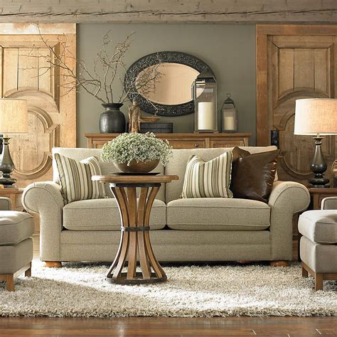 neutral furniture wood accessories mirror with dark frame light neutral couch and rug counseling office design