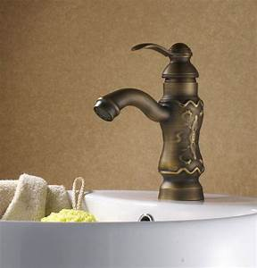 Luxury sculpture art antique brass bathroom faucet for Luxury bathroom faucets