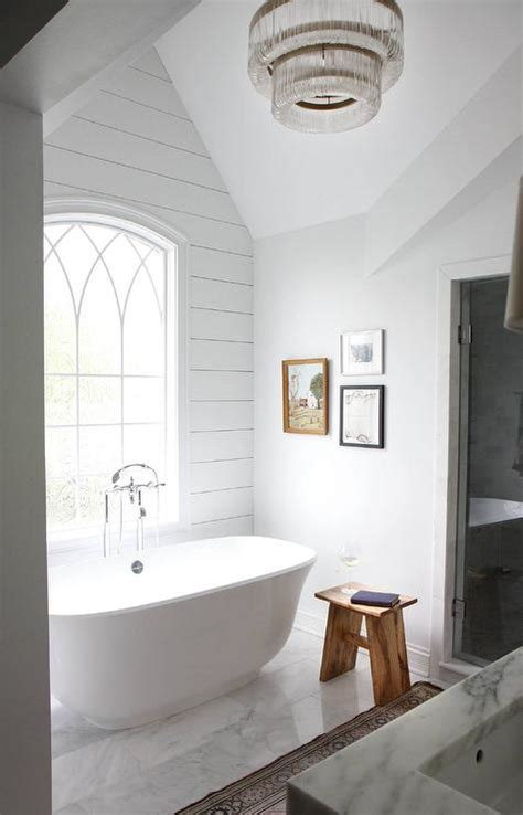 bathtub  arched window cottage bathroom