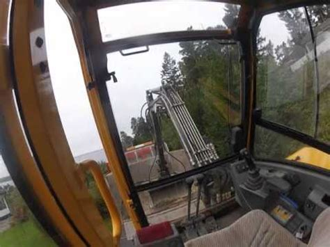 mini excavator climbing  truck  view youtube