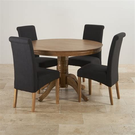 rustic oak round dining table rustic oak round 4ft dining table 4 black fabric chairs