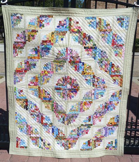 log cabin fabrics curvy log cabin using 100 different floral fabrics