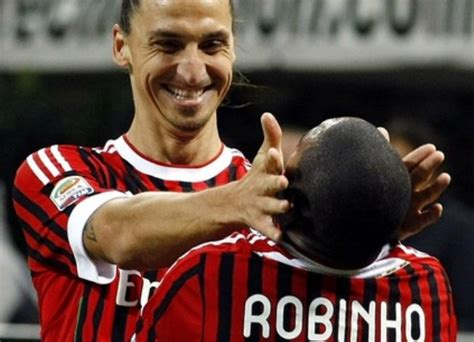 Ac Milan's Robinho is celebrated by his team mate ...