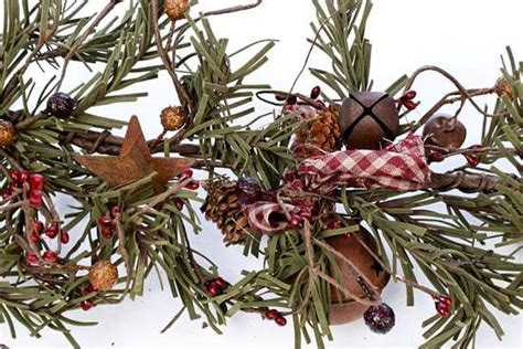 primitive rusty tin bells and artificial pine garland