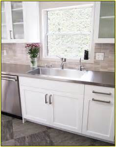 Glass Tile Backsplash with White Cabinets