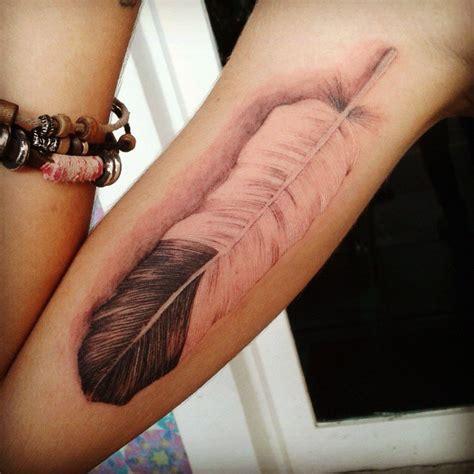 realistic feather  tattoo design ideas