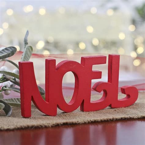 bright red wood noel sign word  letter cutouts