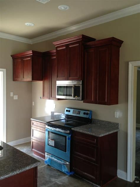 gray kitchen walls with cherry cabinets kitchen walls warm grey will lighten the room but 8348