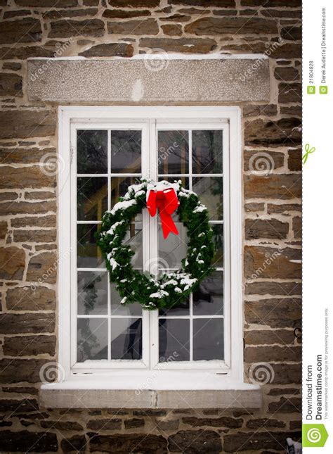 christmas wreath   window pane stock photo image