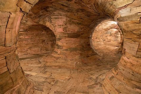 oliveira wood tunnels henrique installation artist tunnel mac wooden giant brazilian builds labyrinth demilked repurposed bois mazes cavernous constructs root