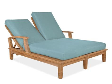 wooden outdoor lounge chair with blue cushion