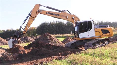 liebherr  excavator backfilling archaeology trail trench youtube
